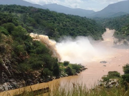 View of the thumping tail race of water of the Kiambere Dam.  Photo Courtesy