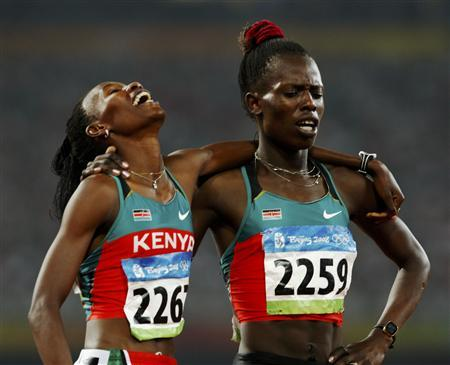 Pamela Chelimo (gold) and Janet Chepkosgei (silver) having a light moment
