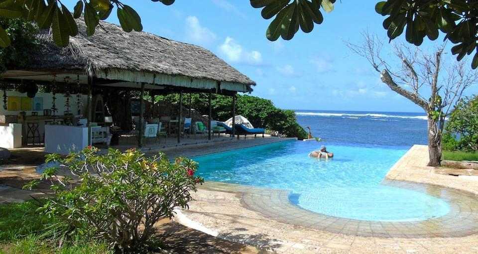 Poolside at Neem Tree House near Kuruwitu. Image Courtesy of Airbnb